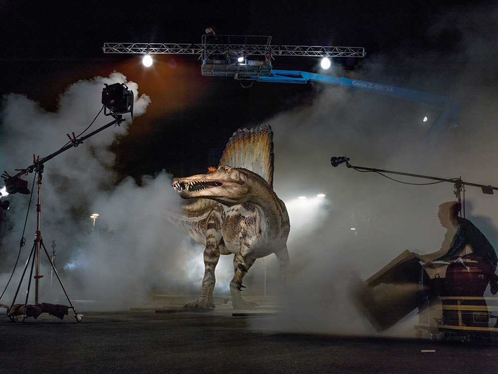 A model of the Cretaceous predator Spinosaurus gets rock star treatment at a photo shoot.