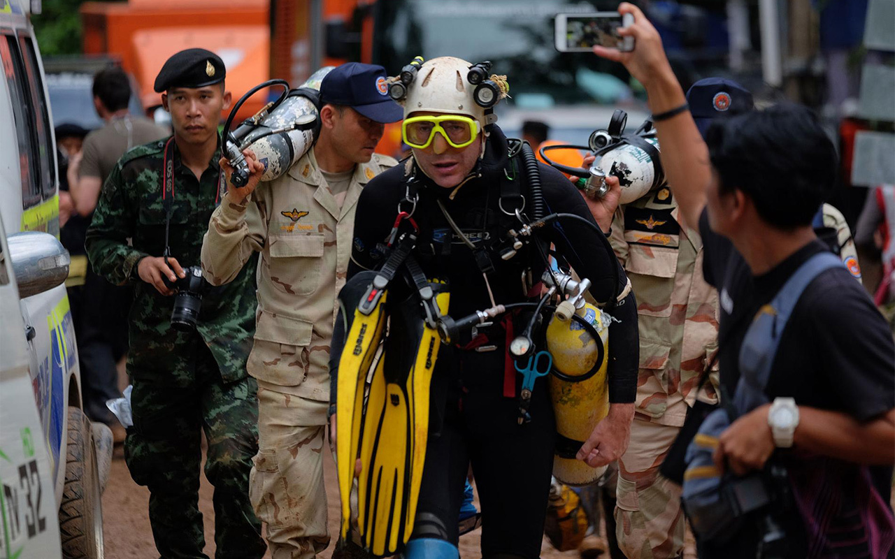 British cave diver John Volanthen emerges from Tham Luang. Volanthan along with Richard Stanton, both elite cave divers from England, found the boys alive a mile and half deep inside the cave.
