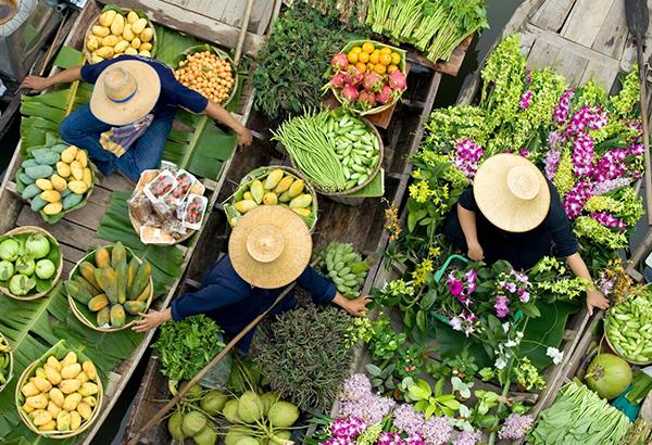 Vendors display their produce at a floating market in Bangkok, Thailand.